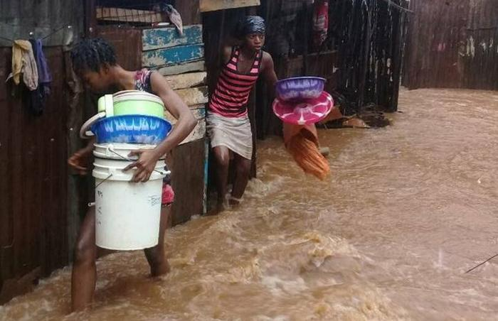 zinc-sheet houses flooded in slums